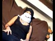 Masked Arabic lady plays with a big black dildo on tape